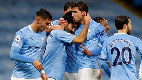 FESTIVE SPIRIT: The players share the love after Gundogan's composed finish.