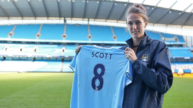 NUMBERS GAME: Jill proudly holds her City shirt aloft after signing for us on November 15th, 2013