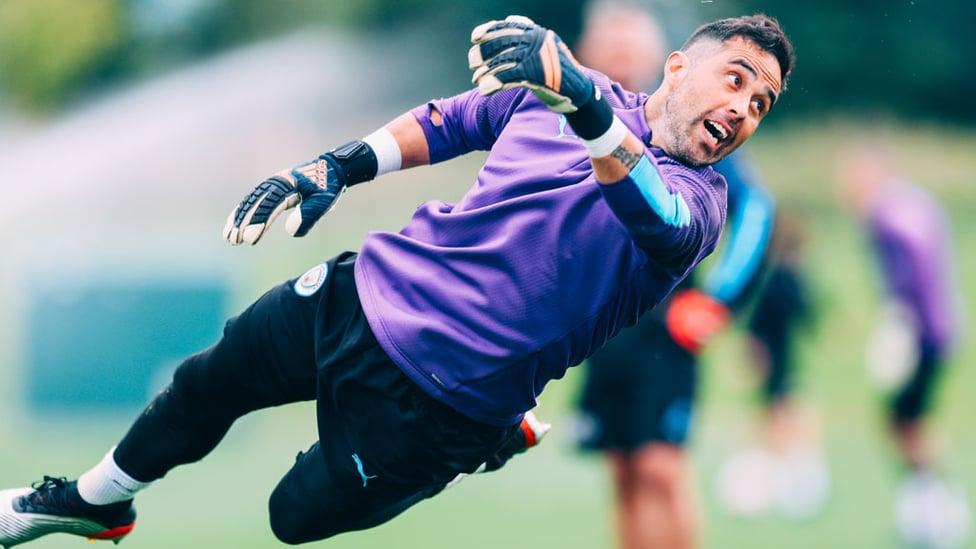 FLYING : Claudio Bravo at full-stretch.