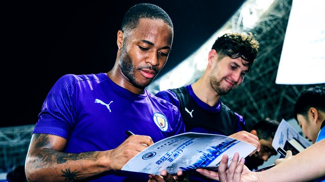 PEN PALS : Raheem Sterling and John Stones sign on the dotted line!