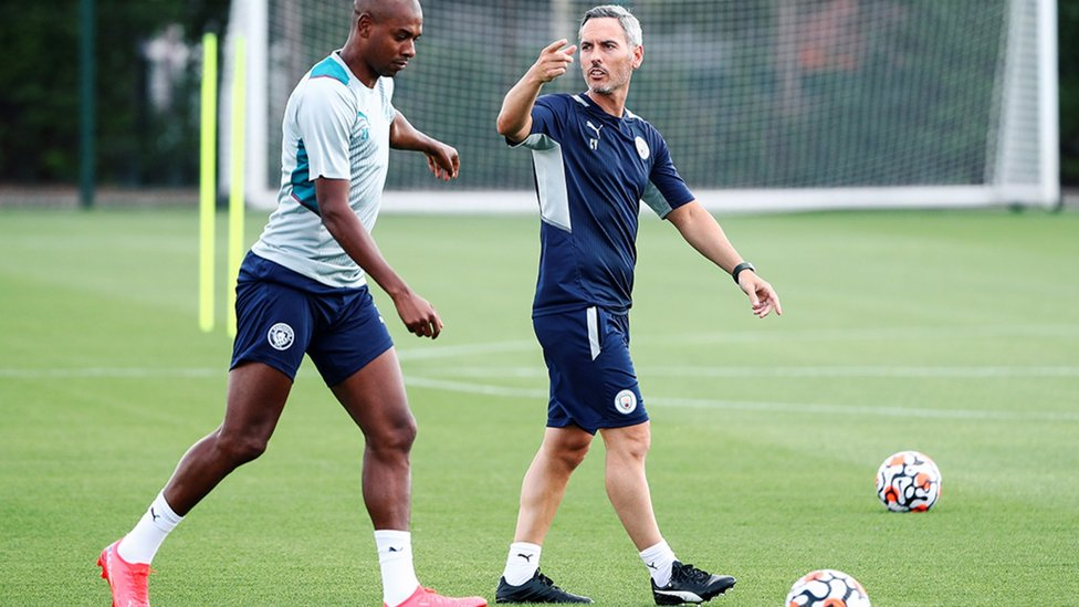 NEXT DRILL: Fernandinho limbers up as Carlos Vicens passes on some instructions