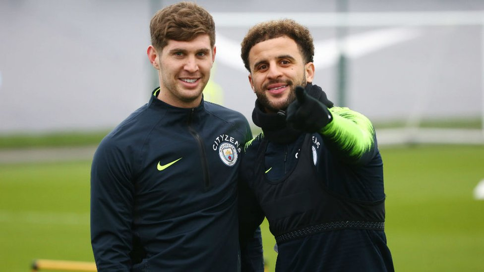 RUMBLED : Kyle Walker and John Stones notice the camera