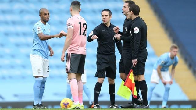 GAME TIME : Fernandinho and Egan share a fist bump as kick-off approaches.