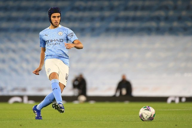: Eric Garcia with protective headgear
