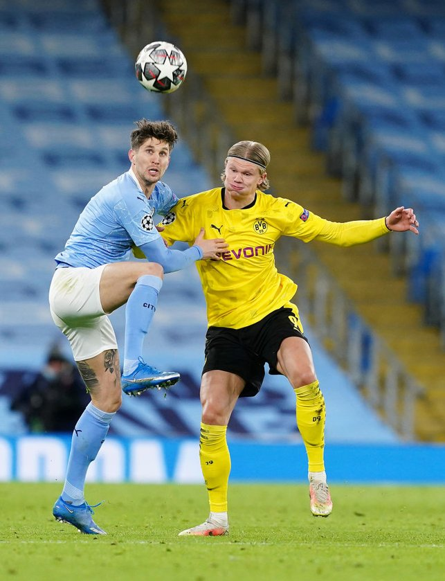 TOUCH TIGHT : Stones and Haaland jostle for possession.