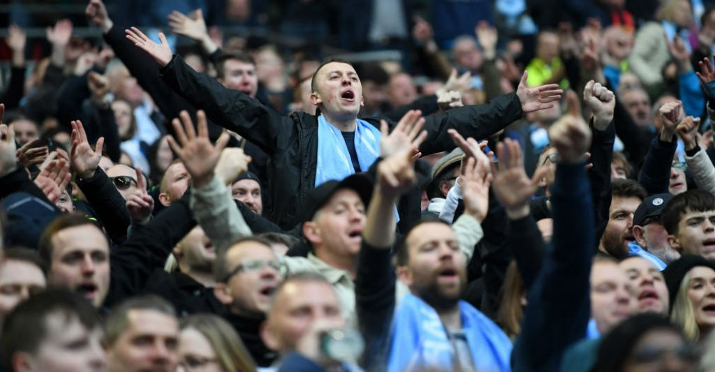 PLENTY TO SHOUT ABOUT: The City fans urge the team on at Wembley