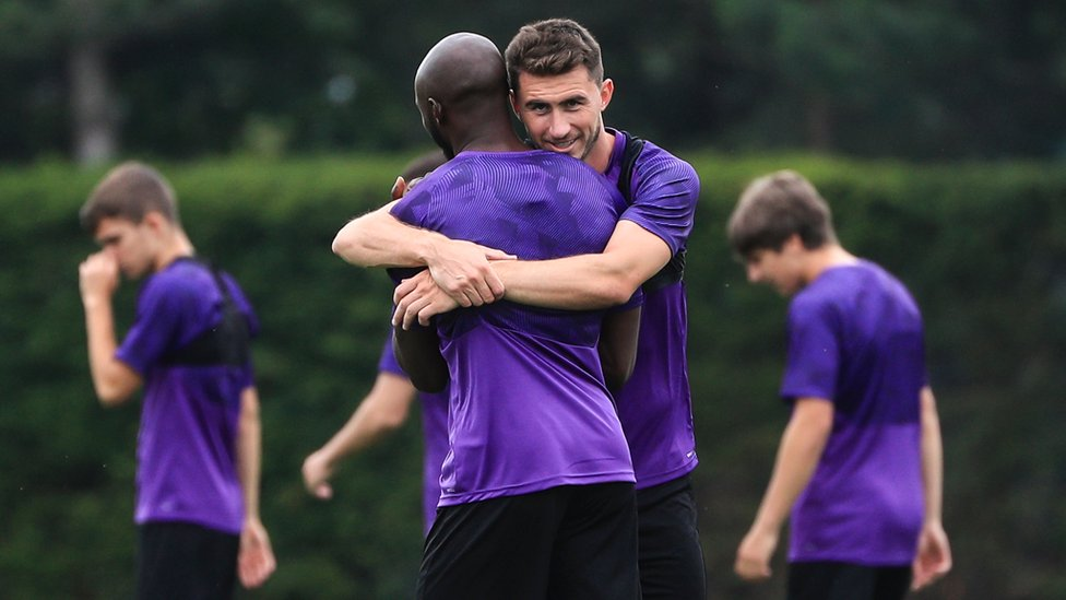 FRENCH CONNECTION : Aymeric Laporte and Eliquim Mangala embrace as they take a quick breather from training
