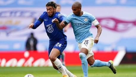 MY BALL: Fernandinho and Reece James battle for possession