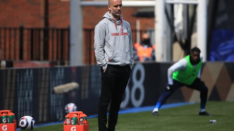 Pep Guardiola watches on from the dugout