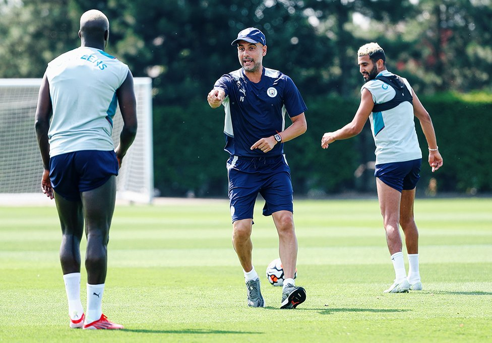 THE BOSS: Pep Guardiola puts the players through their paces