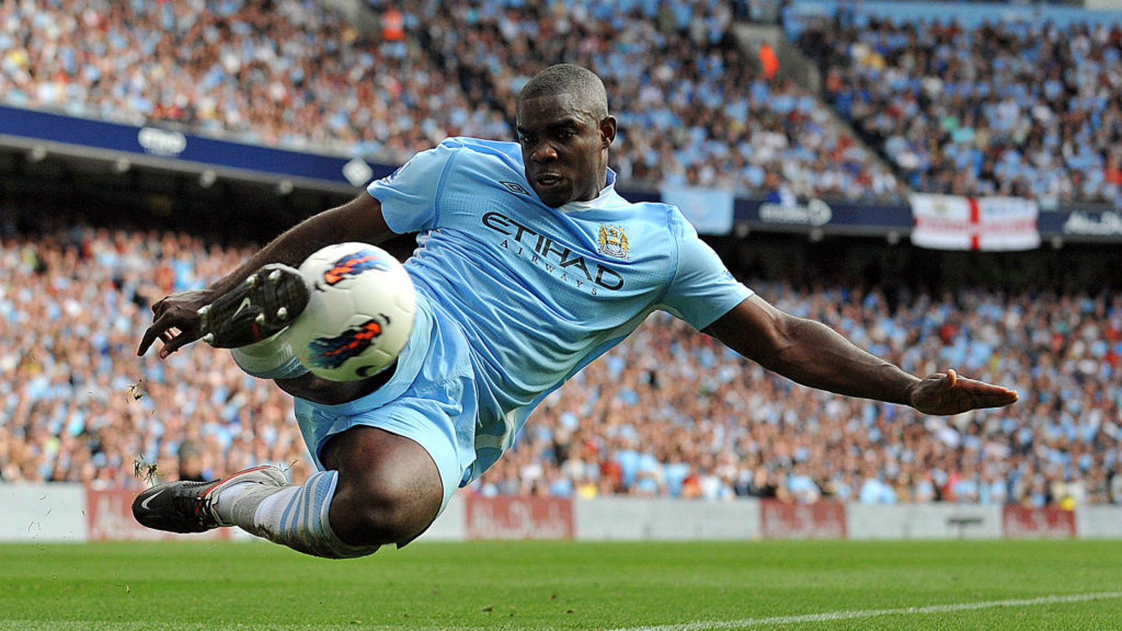 TRUE BLUE: Micah Richards in the thick of the action during his City career