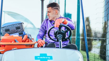 DRIVING FORCE: Ederson swaps the penalty area for the driver's seat.