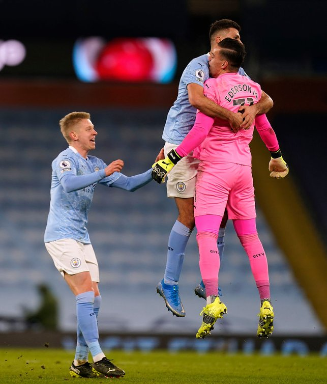 NICE ONE, EDDY : The lads embrace Ederson after his mesmorising assist!
