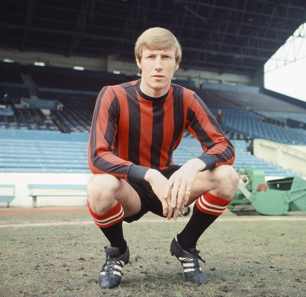 CLASSIC POSE: In our beloved red and black striped shirt