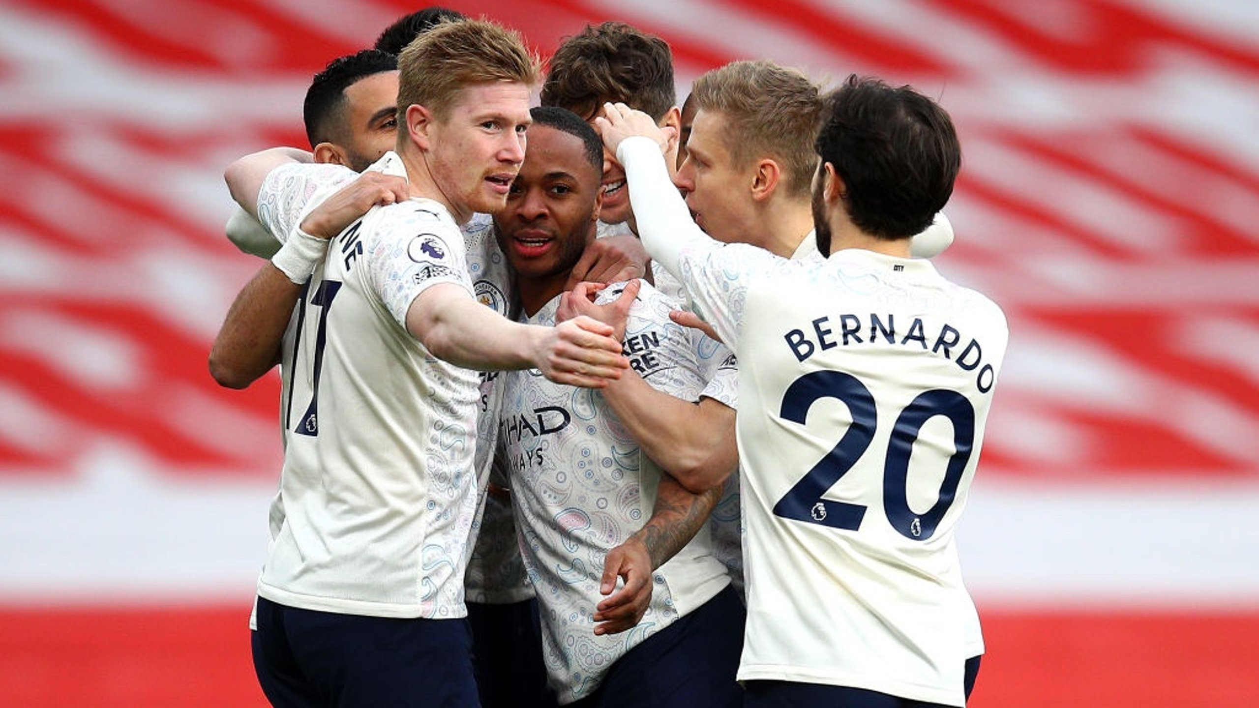 GROUP HUG: The players gather to share the love after Sterling's accurate header.
