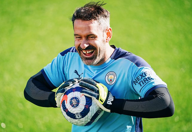 GLOVE STORY: Something has obviously given Scott Carson reason to be cheerful!