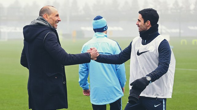 SHAKE ON IT : Martin Petrov exchanges greetings with assistant coach Mikel Arteta