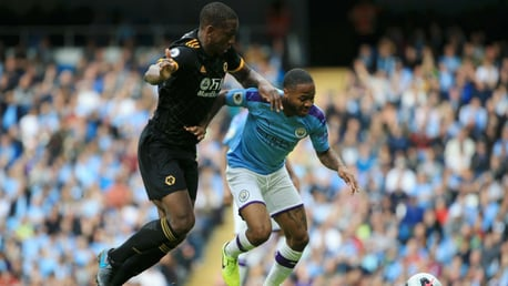 TRICKY CUSTOMER: Sterling holds off Boly in a tense first half.