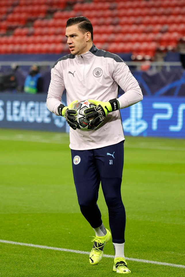 STEADY EDDIE : Our Brazilian shot-stopper gets a feel of the ball during the warm up.