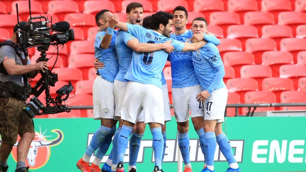 SQUAD GOALS : The players gather to celebrate Laporte's thumping header.