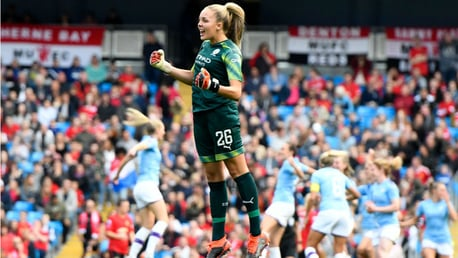 JUMPING FOR JOY: Goalkeeper Ellie Roebuck joins in the celebrations after Caroline Weir's goal