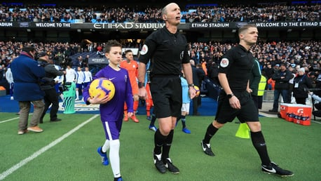MAGIC MOMENT: Bailey walks out at the Etihad Stadium alongside referee Mike Dean