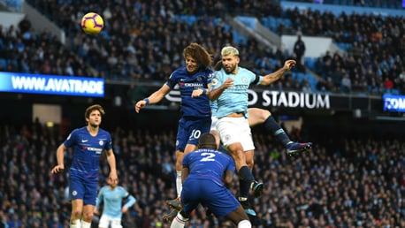 MOVE ON UP: Aguero rises for the ball and lifts City back to the top of the table.
