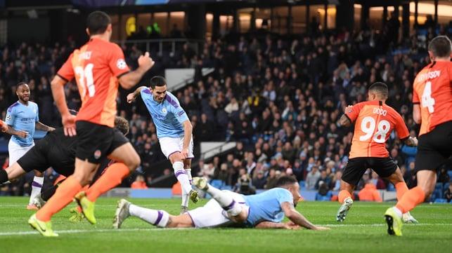 DEADLOCK BROKEN : Ilkay Gundogan opens the scoring, finishing off a well-worked team move
