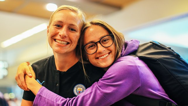 HUG IT OUT : Janine Beckie grabs Pauline Bremer for a snap!