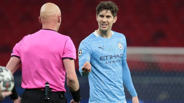 LOST AND FOUND: John Stones gives referee Sergey Karasev his pencil back!