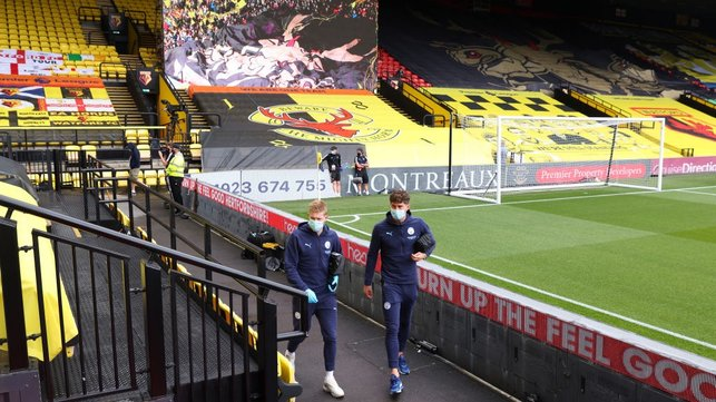 ARRIVAL : De Bruyne and Stones arrive at Vicarage Road.