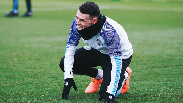 PHIL YOUR BOOTS : Something has given Phil Foden an attack of the giggles!