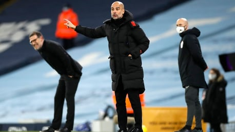 THE BOSS: Guardiola passes on his instructions.