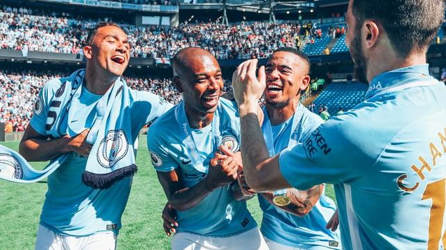 SUNSHINE BOYS : Fernandinho shares in the 2018 title joy with Danilo, Gabriel Jesus and Bernardo Silva