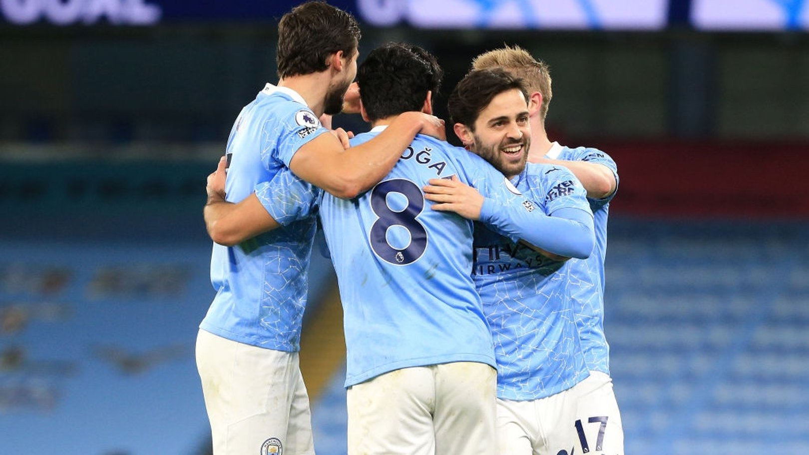 CENTRE OF ATTENTION: The players share the love with Gundogan after his wonderful goal.