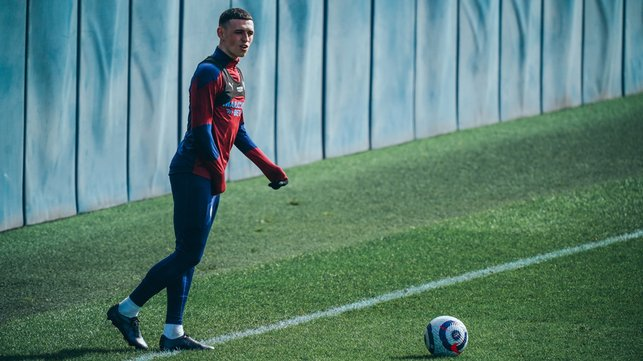 FODEN FOCUS: Phil Foden looks to pick out a teammate