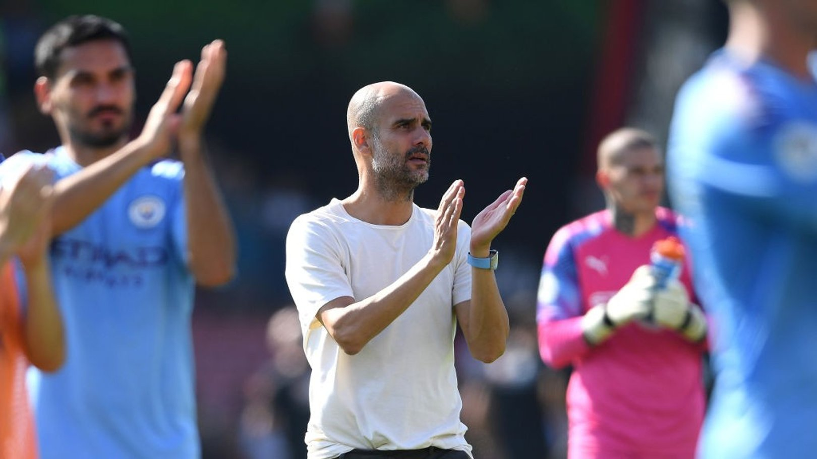APPLAUSE: Pep Guardiola salutes the travelling City fans.