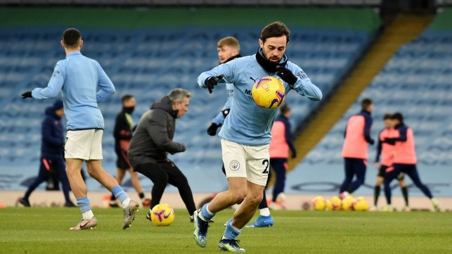 WRAPPED UP : Snood and gloves needed for Bernardo on an icy evening at the Etihad.