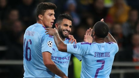 ALL SMILES: Riyad Mahrez celebrates after City's opener