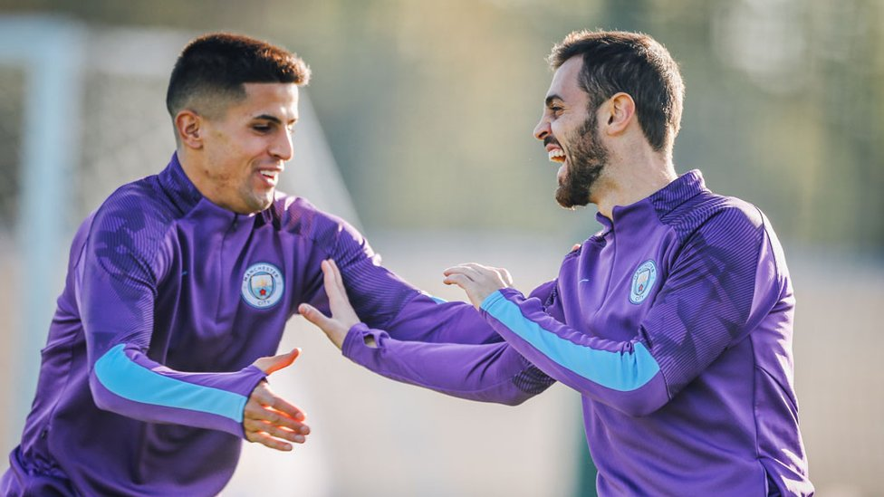 PORTUGUESE PALS : Joao Cancelo and Bernardo Silva share a joke
