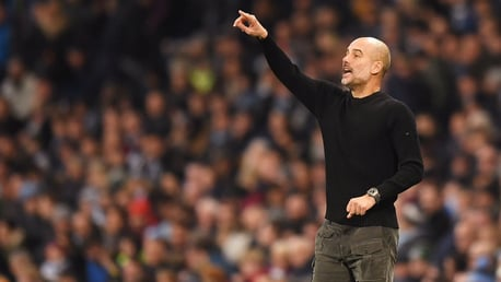 INSTRUCTING: Pep Guardiola makes his point from the touch line.