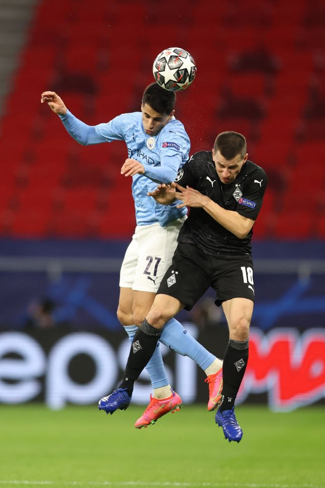 CANCELO'D OUT: Joao Cancelo rises highest to clear the danger