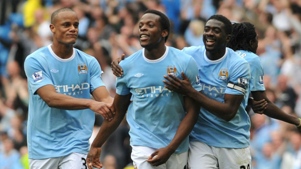 ALL SMILES: Nedum Onuoha celebrates a City goal with Vincent Kompany and Kolo Toure