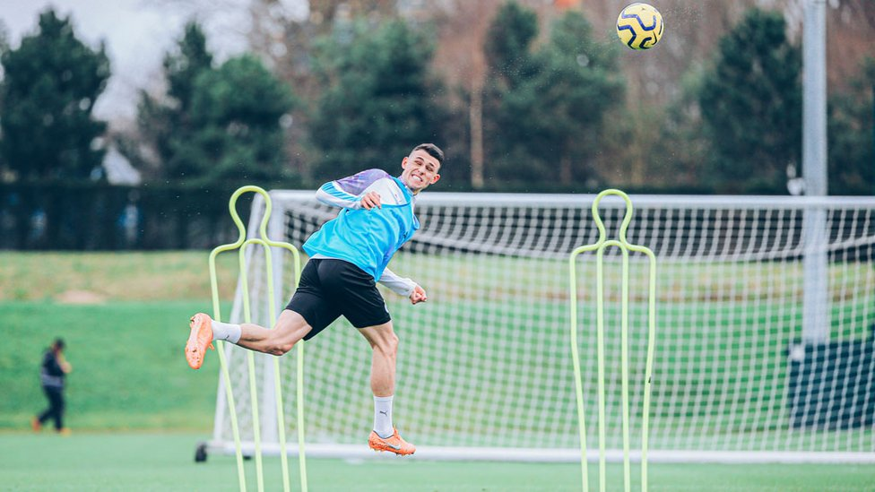 ON THE UP : Phil Foden leaps for a header