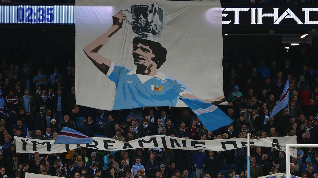 REMEMBERED : Mike Doyle flag at the Etihad
