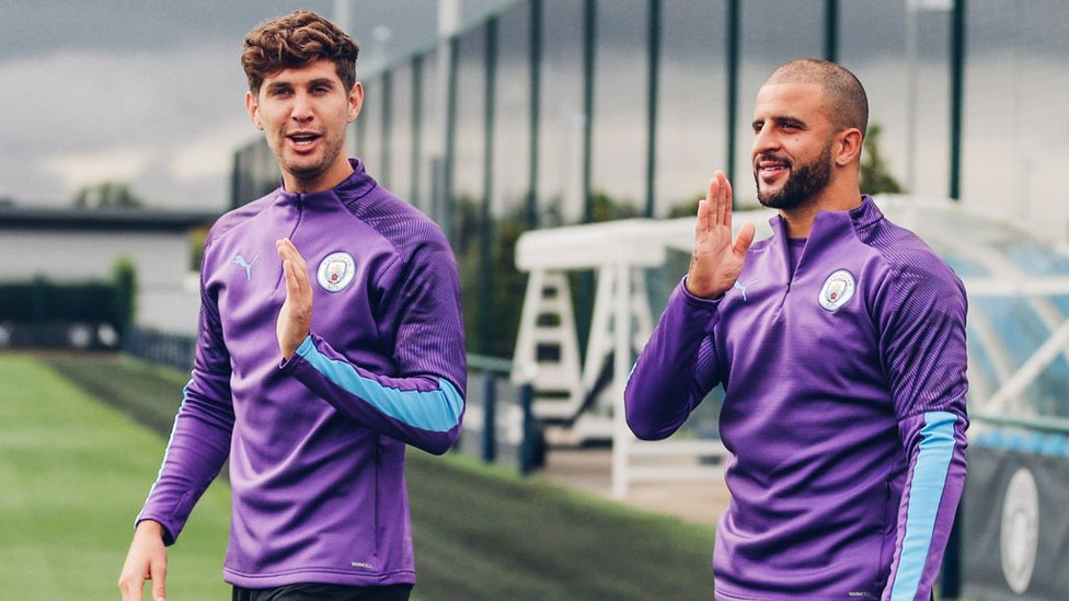 BLUES BORTHERS : John Stones and Kyle Walker prepare for Tuesday's session