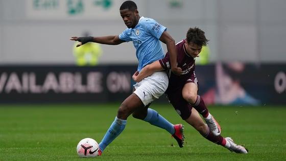 MBETE-RING RAM: Luke Mbete shields the ball from Jake Wakeling