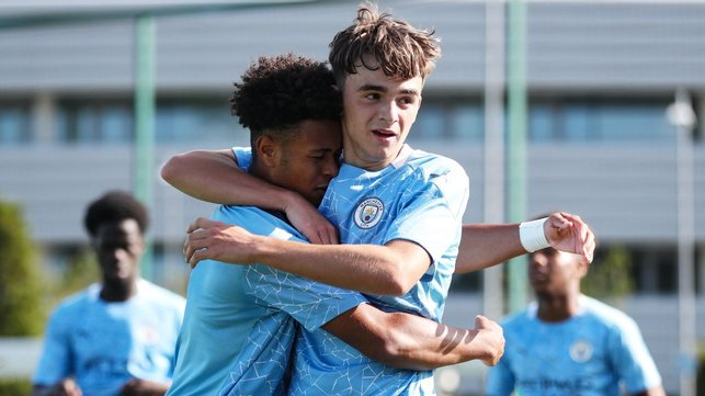 ALL SMILES: Tai Sodje and Harvey Griffiths celebrate during City's league win against Everton Under-18s