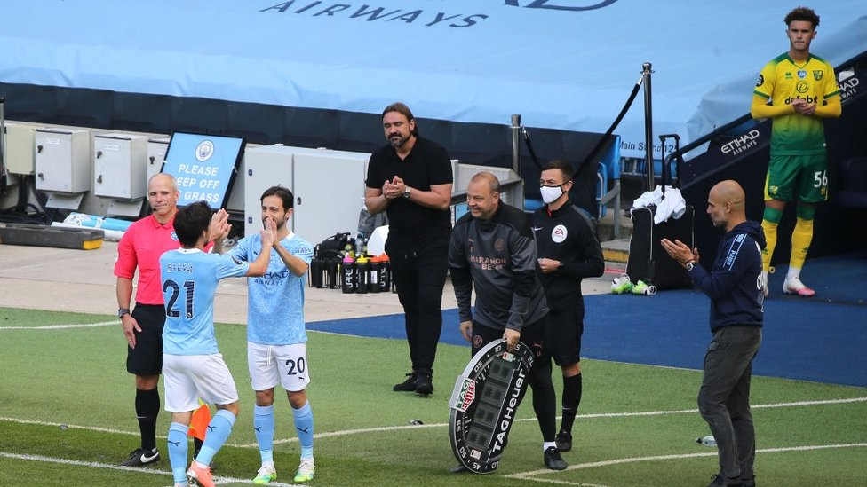 OVER AND OUT : Silva makes his way off the pitch late on in his final ever City league match.