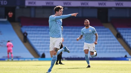 STONE COLD: The defender celebrates his accurate goal.